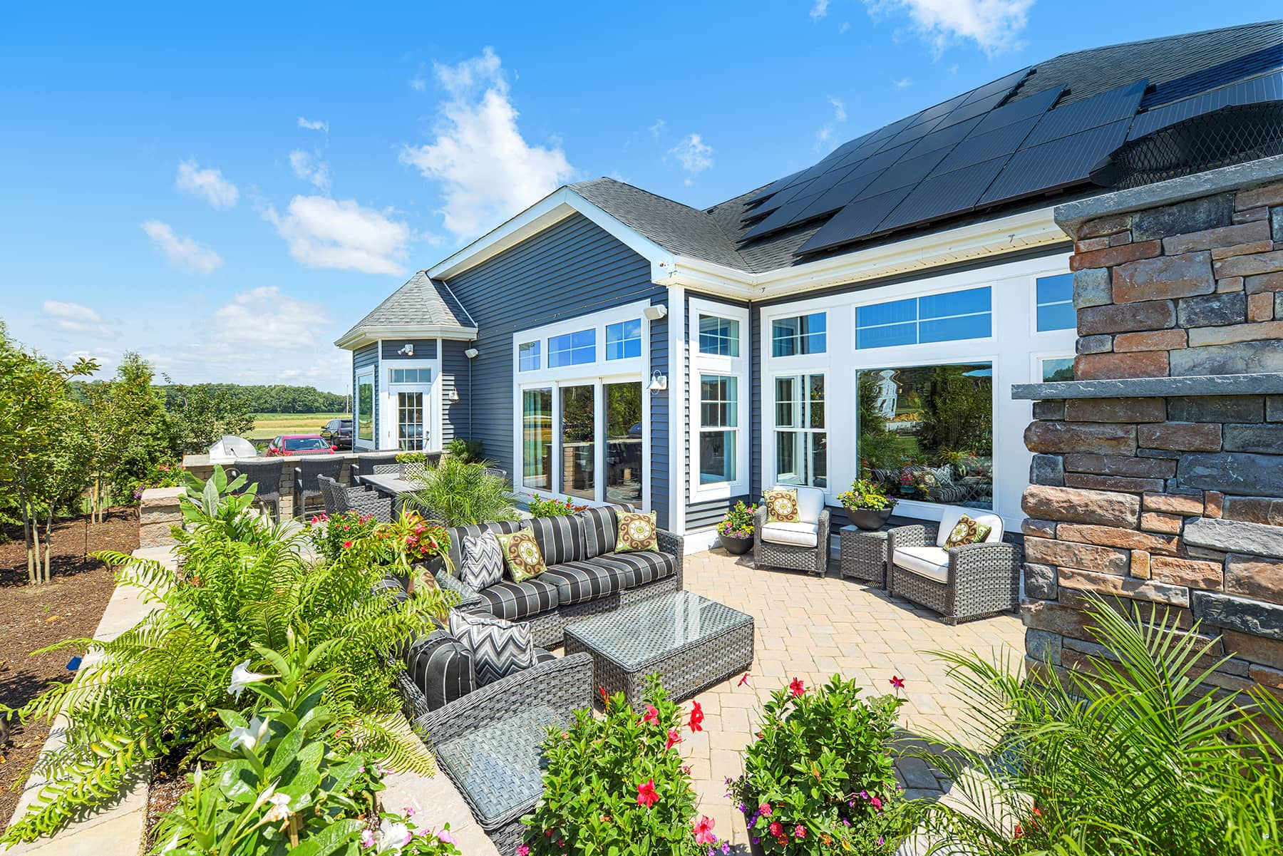 Beautiful shot of backyard with solar panels on roof of house
