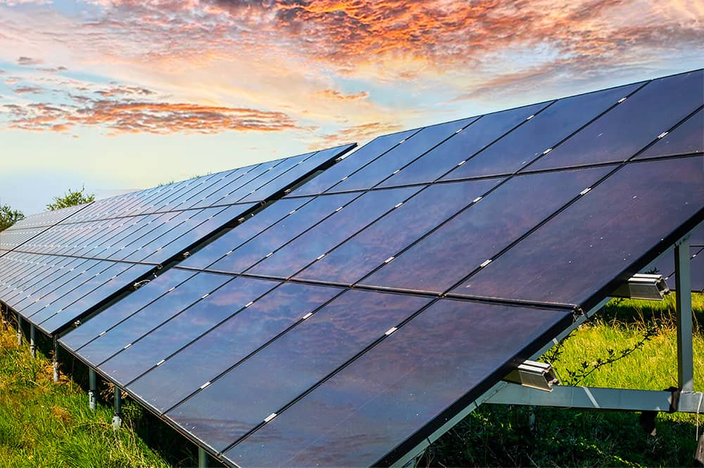 Solar Panels in field with beautiful sky in background