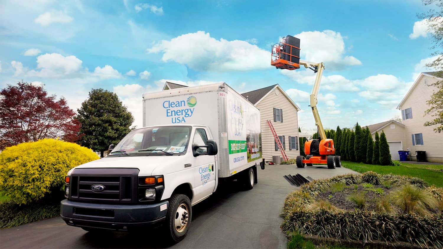 Clean Energy USA Truck with crane in background installing solar panel on residential roof
