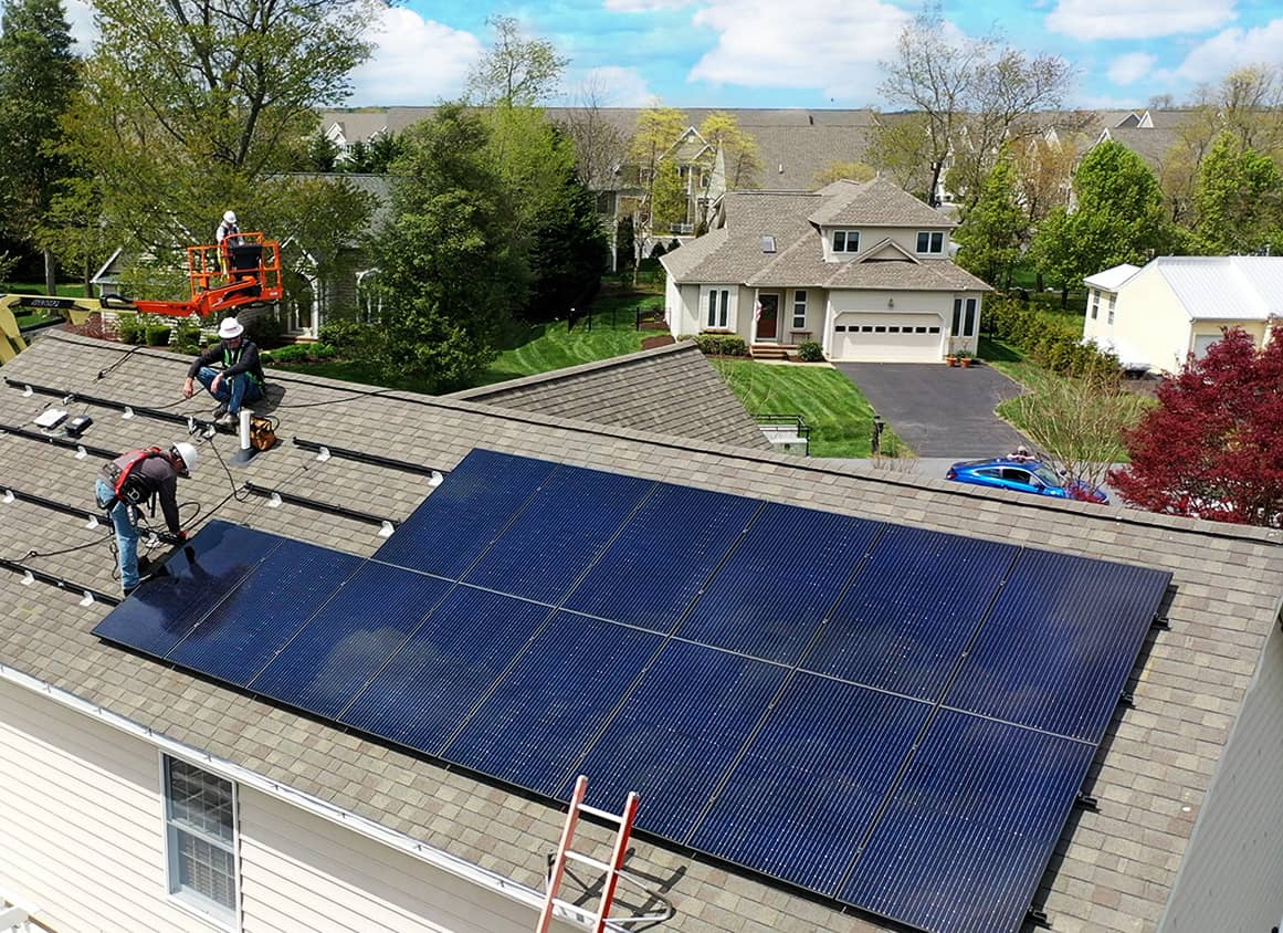 Clean Energy USA workers installing solar panels on residential home roof