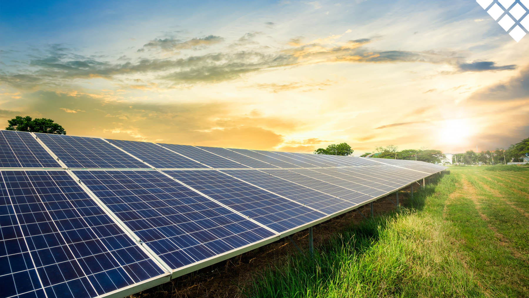 Solar panel cell on dramatic sunset sky background